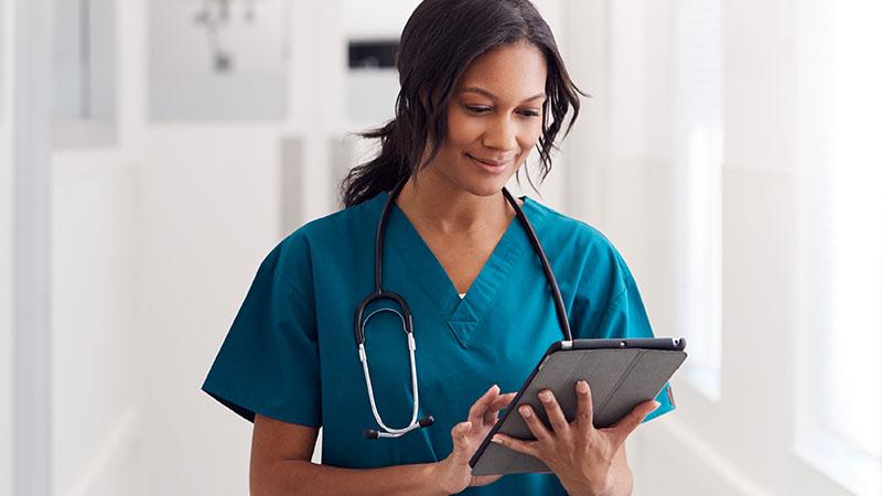 nurse working on tablet