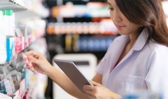 pharmacist using tablet looking at medication