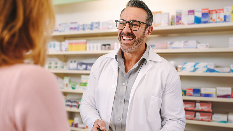 pharmacist smiling at patient