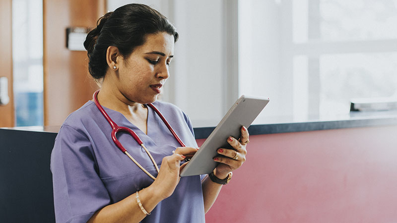 nurse working on tablet